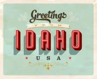 Saludos del vintage de la tarjeta de vacaciones de Idaho ilustración del vector