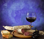 Salumi, quesos y vino Imagen de archivo libre de regalías