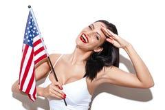 Salut sexy de femme avec le drapeau des Etats-Unis Image stock