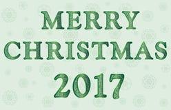 Salutation avec le Joyeux Noël aux nuances du vert Images stock