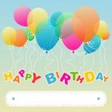 Salutation d'anniversaire avec les ballons de flottement Photo libre de droits