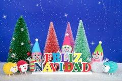 Salutation de Noël de bonhommes de neige et de moutons dans l'Espagnol Photo stock