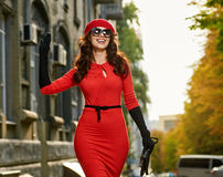 Salutation of young woman in the city Stock Photography