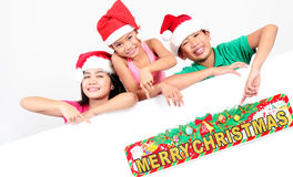 Salutations de Chistmas des enfants Photos libres de droits