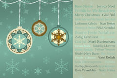 Salutations de Noël dans beaucoup de langues sur le rétro fond de Noël Photos stock