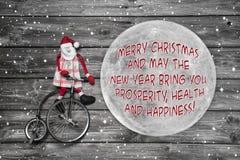 Salutations de Noël de Worlwide sur le globe - carte avec Santa et Image stock