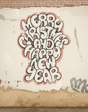 Salutations de Noël, jet peint, sur le vieux mur. Photographie stock