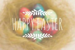 Salutations de Pâques sur un fond brouillé avec Photos libres de droits