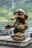 Norwegian Troll. Salutatory wodden Troll figurine at the port of the Geiranger Fjord in Norway Stock Photo