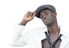 Salute. Young black adult raising his hand to his cap Royalty Free Stock Image