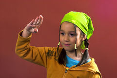 Salute. Young girl with a green kerchief saluting Stock Image