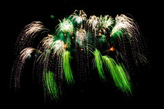 Salute. Bright celebratory multi-coloured salute in the black sky Stock Images