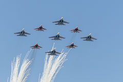 Salute Aerobatic team Swifts and Russian Knights fly over Red Square Stock Image