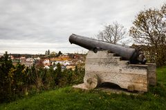 Salute canon standing on Kirkeheia, with Grimstad city seen below in the background. Royalty Free Stock Photo