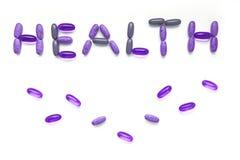Salute dell'iscrizione da un insieme delle pillole variopinte isolate su fondo bianco fotografia stock libera da diritti