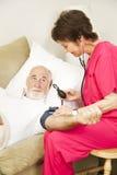 Salute domestica - verticale di pressione sanguigna Immagini Stock