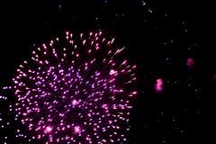 Salute, fireworks in the night sky. Pyrotechnic show on a holiday. Explosion of many firecrackers royalty free stock images