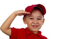 salutera för pojke arkivfoto