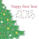 Saluti con l'albero di Natale e le luci di Natale decorati Fotografia Stock