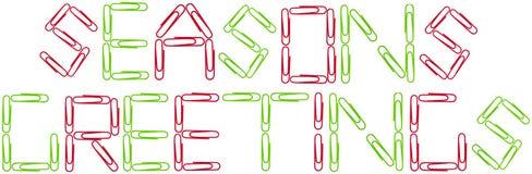 Saluti del Seanson rossi e clip del Libro Verde Fotografie Stock