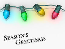 Saluti della stagione degli indicatori luminosi di natale. Fotografia Stock