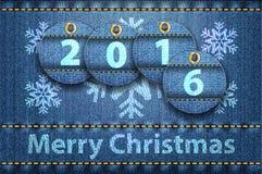 Saluti di Buon Natale sulla priorità bassa delle blue jeans Fotografia Stock