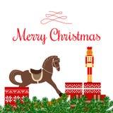 Saluti di Natale con i giocattoli ed i regali Immagine Stock