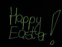 Saluti di Pasqua dipinti con verde chiaro. Immagine Stock