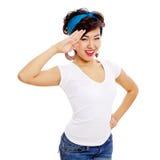 Saluting asian pin up girl Stock Photo