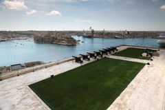 Saluting Battery. The saluting battery and the View across Grand Harbour, Malta Stock Photo