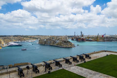 The Saluting Battery Canons and Grand Harbour - Valletta, Malta Stock Photos