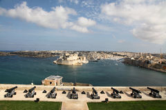 Saluting battery and Grand harbour, Malta. A top view of the saluting battery overlooking the Grand Habour and Fort St. Angelo on the fortress island of Malta Royalty Free Stock Photography