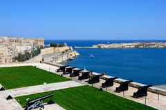 The Saluting Battery, Malta. The Saluting Battery seen from the Upper Barrakka Gardens with views over the bay towards Fort Rikasoli, Valletta, Malta, Europe Stock Images