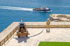 Saluting Battery in Valletta with the guard. Valletta, Malta - June 4, 2017: View of  Saluting Battery from the Upper Barrakka Gardens, with the guard in uniform Stock Photo