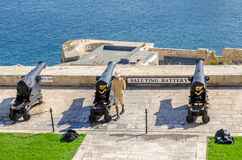 Saluting Battery in Valletta with the guard. Valletta, Malta - November 8, 2015: View of Saluting Battery from the Upper Barrakka Gardens, with the guard in Stock Images