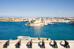 Saluting Battery, Valletta, Malta. The Saluting Battery of La Valletta and Fort St. Angelo of La Vittoriosa in Malta Royalty Free Stock Image