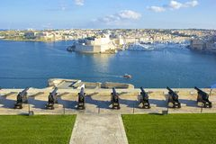 Saluting Battery, Valletta, Malta. The Saluting Battery of La Valletta and Fort St. Angelo of La Vittoriosa in Malta Stock Photo