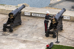Saluting Battery. VALLETTA, MALTA - March 23: Maltese soldier preparing the Saluting Battery for gun fire on March 23, 2014 in Valletta, Malta. For almost 500 Royalty Free Stock Image