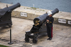 Saluting Battery. VALLETTA, MALTA - March 23: Maltese soldier preparing the Saluting Battery for gun fire on March 23, 2014 in Valletta, Malta. For almost 500 Stock Photo