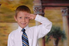 Saluting Boy Stock Photo