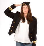 Saluting girl with officer uniform Stock Images