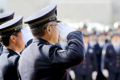 Saluting Japanese police officers royalty free stock photos