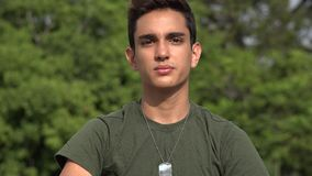 Saluting Male Hispanic Teenage Soldier Recruit. A handsome hispanic male teen stock video
