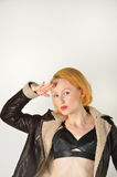Saluting Red Head in jacket Stock Photos
