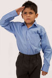 Saluting School Boy. Asian Young School boy Saluting royalty free stock images