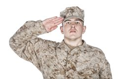 Saluting and smiling army soldier studio shoot stock images