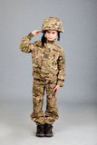 Saluting soldier. Young boy dressed like a soldier Stock Photos