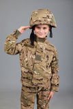 Saluting soldier. Young boy dressed like a soldier Stock Photo