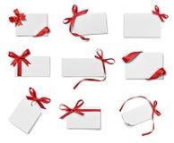 Saluto di celebrazione di chirstmas della nota della carta dell'arco del nastro Fotografia Stock