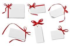 Saluto di celebrazione di chirstmas della nota della carta dell'arco del nastro Fotografie Stock